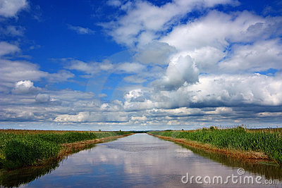 Water canal, blue sky