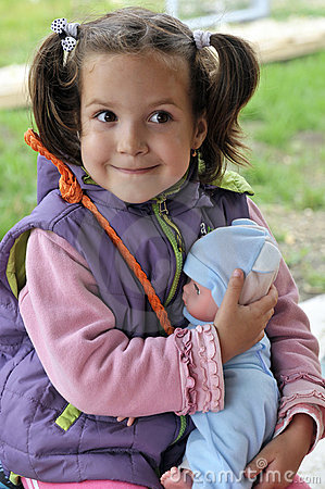 Little girl holding a doll