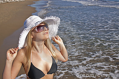 Young smiling blond woman on a beach