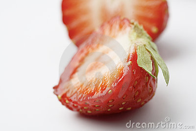 An extreme close-up of a fresh strawberry.