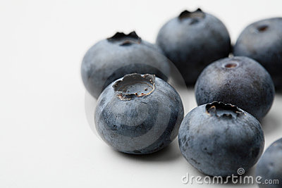 An extreme close-up of fresh blueberries.