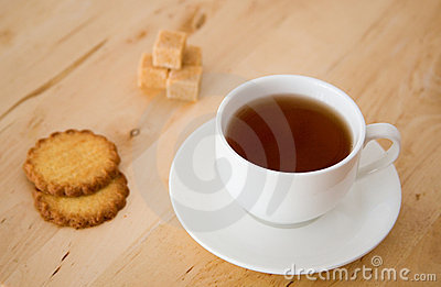 Black tea, sugar and biscuits