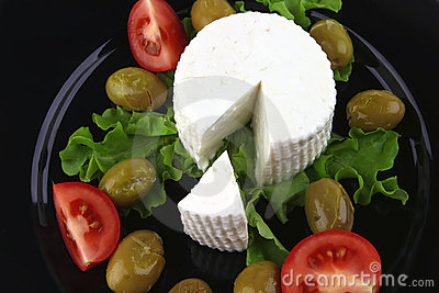 Soft feta cheese with tomato olives