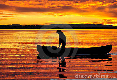 Canoeist at sunset