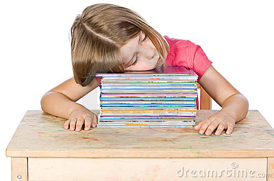 Young Child Falling Asleep on her Books