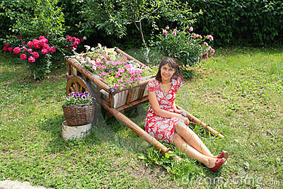 Young woman sitting in the garden