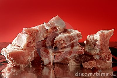 Pig, pork raw meat pieces over red
