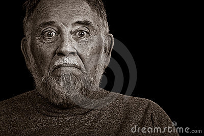 An Elderly Man With A Worried Look