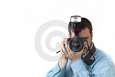 Young man photographing on white