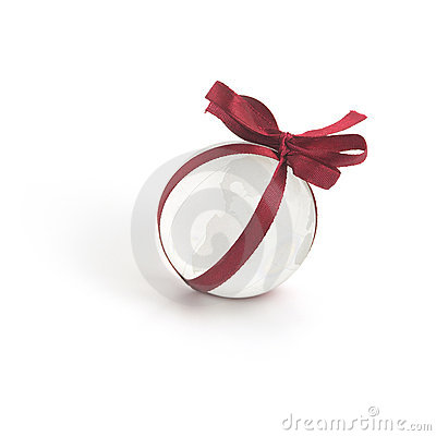 Glass globe and red ribbon