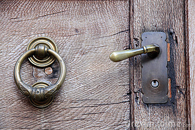Doorknob and knocker on old wooden door