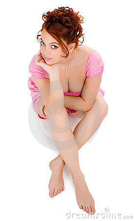 Woman sitting in pink dress