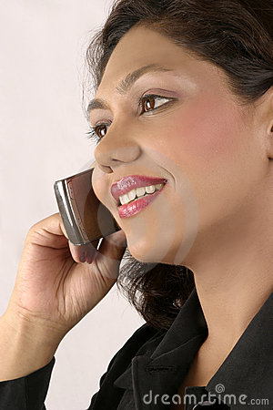 beautiful Indian girl calling on mobile phone