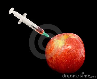 Red apple with syringe on black