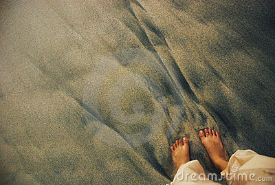 Foot on sand beach