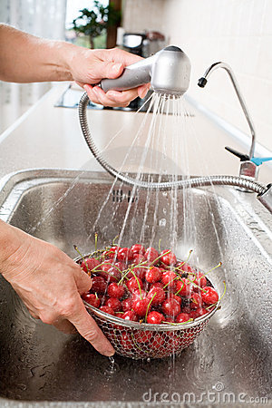 Washing cherry in sink