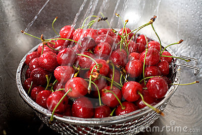 Wet fresh cherry in sink