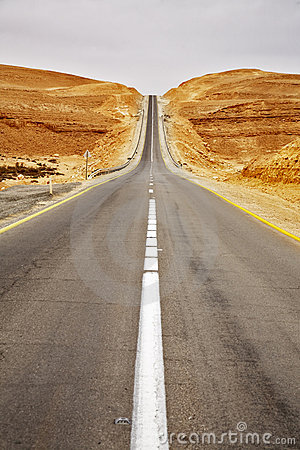 Asphalt highway in desert