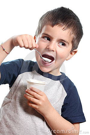 Little boy eat yougurt