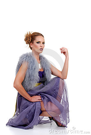 Fashion model with purple dress fur vest