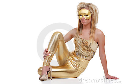 Woman wearing gold outfit sitting