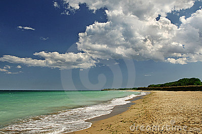 Beach landscape with clouds and sand