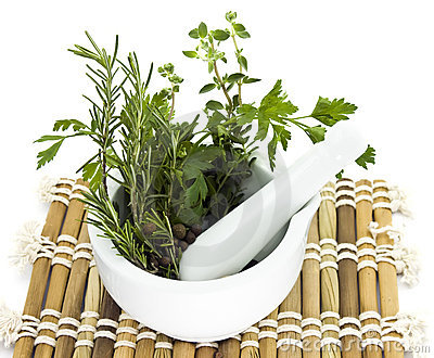 Mortar and pestle with herbs