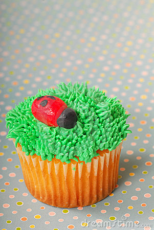 Cupcake decorated with grass frosting