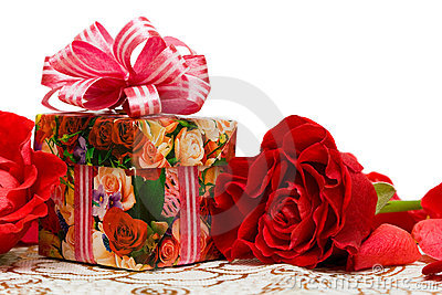 Gift box with rose on a silk