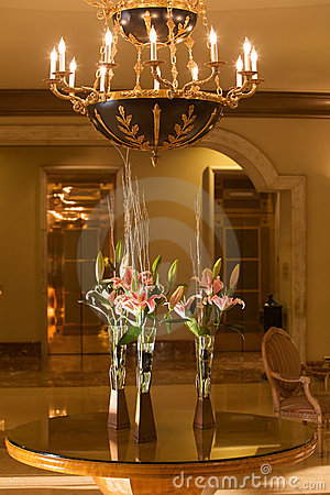 Hotel lobby with chandelier and flowers