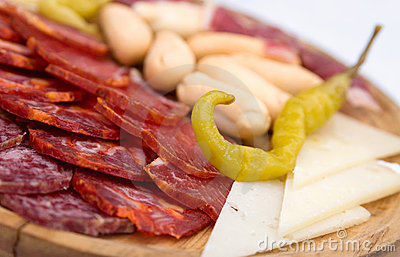 Appetizer platter of cold meats with green chili
