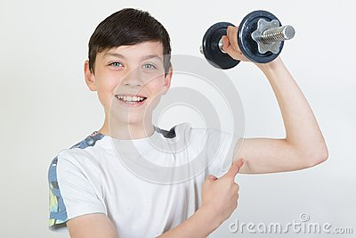 Boy using dumbbell weights