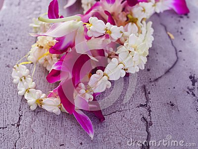 White small fresh real crown flower Giant Indian Milkweed, Swallowwort and purple Thai local orchid garland string messy pile on