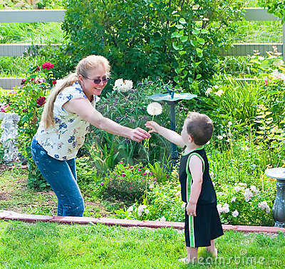 Grandmother playing with her grandson in the backy