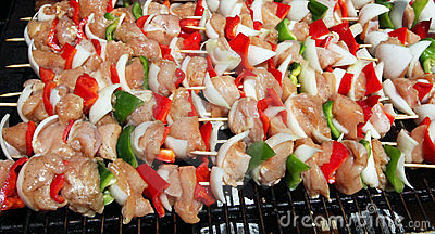 Shish kebobs grilling outdoors