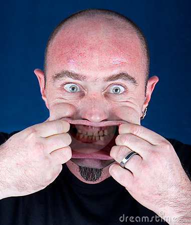 Man stretching his mouth to make a funny face