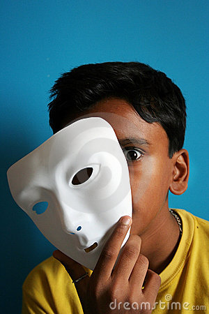Boy removing the mask