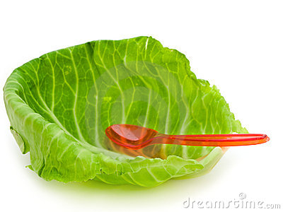 Cabbage leaf and spoon