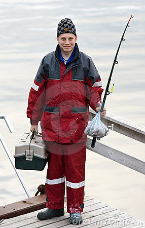 Teenager with fishing tackle