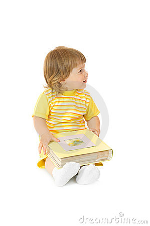Small girl with family album