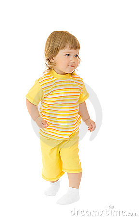 Small girl in yellow shirt and pants