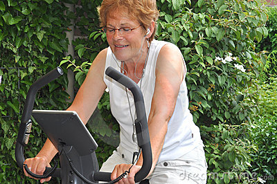 Senior woman listening to music during workout