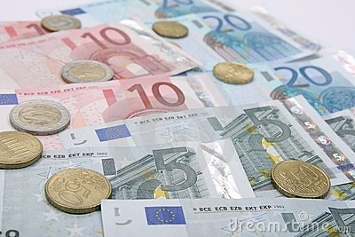 Euro coins with banknotes