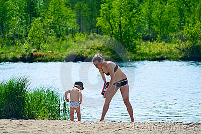 Mother And Child Near A Lake