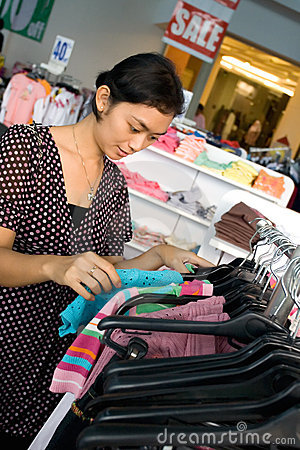 Young woman shopping on sale
