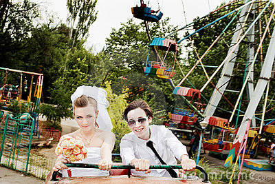 Bride and groom in amusement park