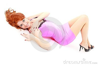 Red haired woman in little pink dress