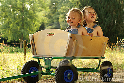 2 Pretty girls in a wagon