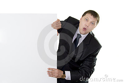 Businessman looking out from behind a blank
