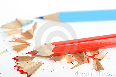 Color pencil and sharpener with a shaving